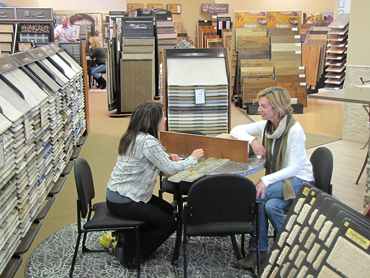 A Floor Club Specialist helps a customer with her flooring selection
